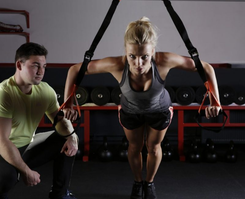 woman following advice from trainer